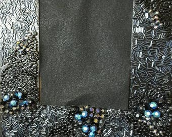 Black, blue and silver bead and sparkle wall frame