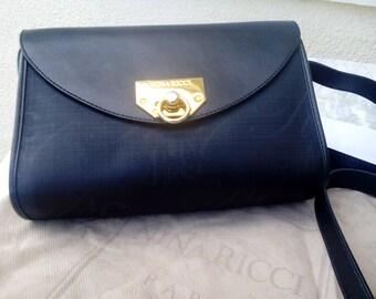 NINA RICCI shoulder bag, vintage classic black leather/jacquard fabric shoulder bag from the 1980's.