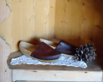 Wooden clogs and leather