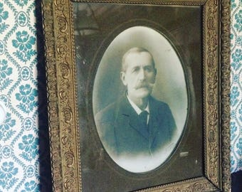 Beautiful frame with moldings worked from the 19th century. Portrait of man with mustache. antique french. Large frame.