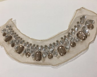 Neckline patch in beads and stone detail in neutral shade