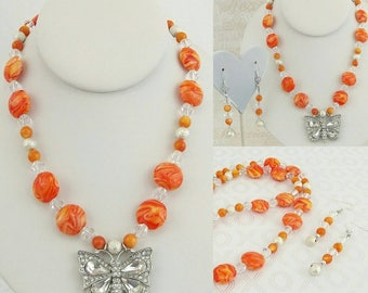 Orange swirl beaded necklace with matching earrings