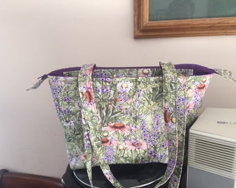 Quilted green and purple shoulder bag with recessed zipper