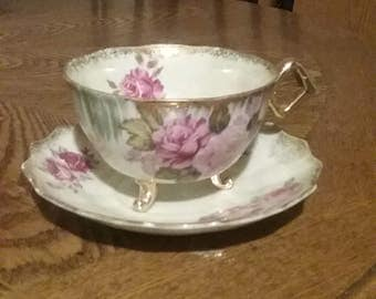 Japanese three footed cup and saucer handpainted