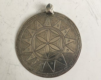 silver Bedouin pendant, circular pendant with symmetrical pattern, from Upper Egypt