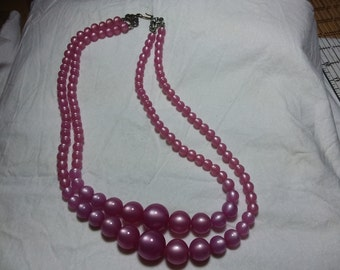 Vintage pink luster looking beaded necklace.  Two strand