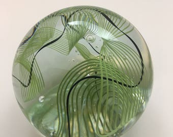 Handmade Glass Paperweight with Green and Black Line Pattern