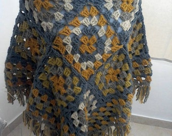 Crocheted poncho with fringes