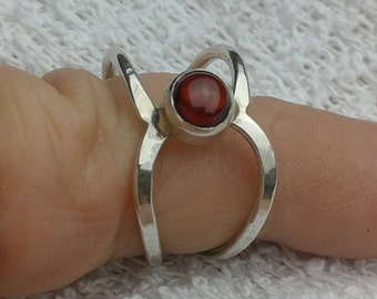 Different style garnet ring. Tube set. Sterling silver.
