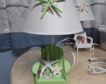 Green beach chair lamp with seashell decorated shade