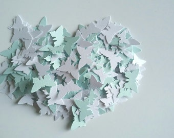 Handmade butterfly shaped table confetti in pastel blue and white