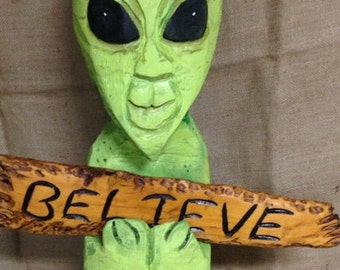 Chainsaw Carved Alien With Believe Sign