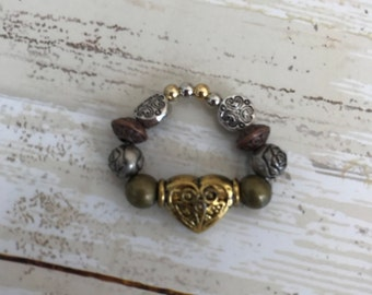 Metallic heart ring