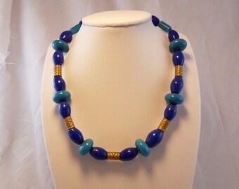 Vintage Art Deco blue lapis bead and brass necklace