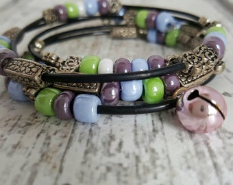 Wrap bracelet with beads and call