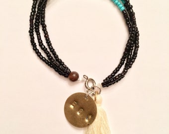 Black amd Turquoise 3-strand bracelet