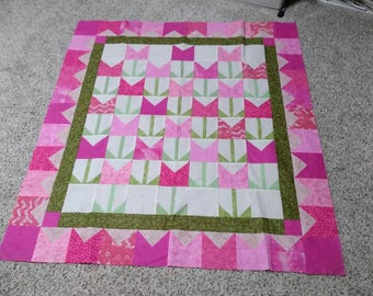 A cute little quilt top made into pink tulips