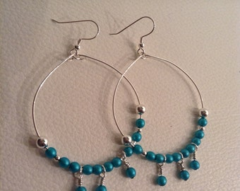 Silver earrings made with glass and silver pearls
