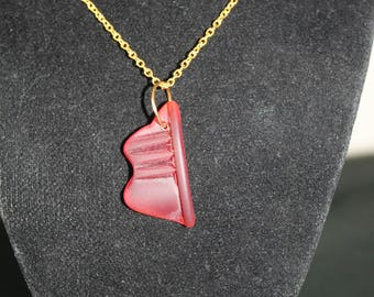 red glass necklace on gold chain