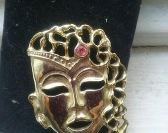 Vintage mascara themed brooch
