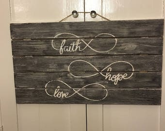 Faith, Hope, Love -Distressed wood sign with quotation or inspirational saying