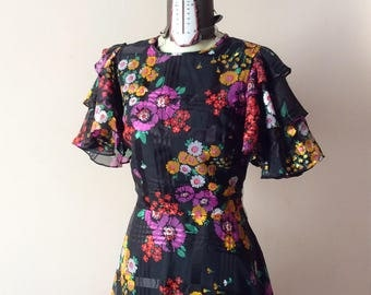 Vintage floral print 70 years. Goddess of nature in black! Size 42