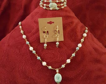 Beautiful hand made gemstone necklace bracelet and earrings. One if a kind and made with love.