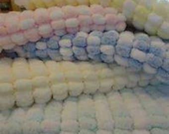 Beautiful soft hand knitted baby pram blankets in Rico pom pom wool