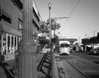 Black and white fine art photography print, architecture in San Francisco, antique streetcar, electric trolley in the city, square photo