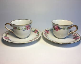 Floral Demitasse Cup and Saucer Pair–White, Pink, and Gold–Charles Ahrenfeldt, France, made for Wright, Tyndale, & Van Roden, Philadelphia