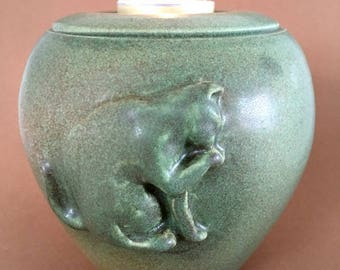 URN for cat, with tangible image of shining cat. Capacity 0.25 L color: mixed Pears green.