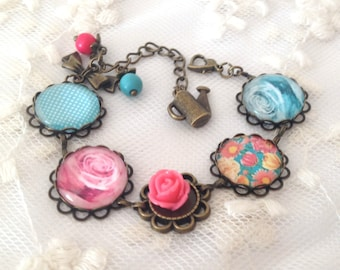 Bracelet cameo blue and pink flowers.