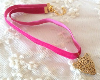 Fuchsia chocker with Golden Tiger necklace.