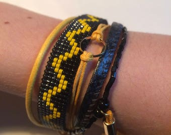 Cuff multi row bracelet black and yellow