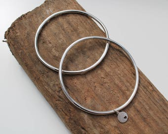 Set of two sterling silver bangles.