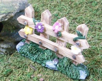 Miniature fence with grass and vining flowers for Fairy garden or terrariums