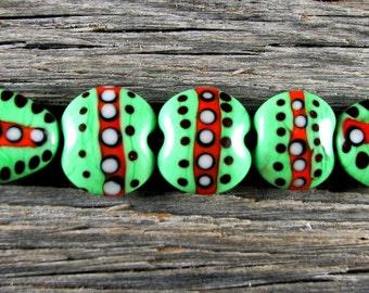 Repeating Pattern Style...7 Handmade Lampwork Lentil and Shield Bead Set Sra
