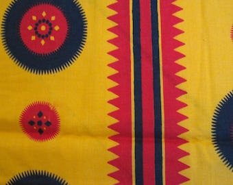 """1930s novelty print fabric -- warm yellow, red, black -- stripes and sprockets, graphic, geometric, bold -- 42"""" x 66"""", 1 + yard"""