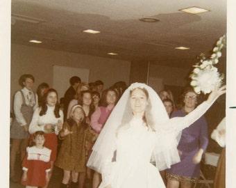 Vintage photo 1970 Color Snapshot Bride Tossing Bridal Bouquet into Air