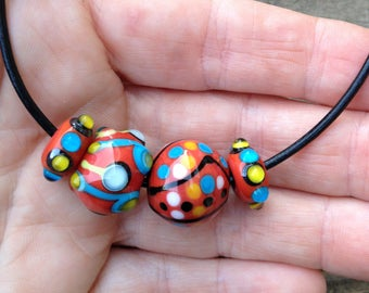 Small Lampwork Bead Set in Mesa Red With Turquoise Black and Yellow Artisan Handmade Glass Beads For Jewelry Design