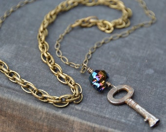 Skeleton Key. Swarovski crystal skull and antique key on long brass necklace. Charm necklace, skull jewelry