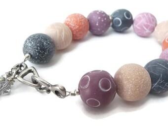 Polymer Clay Bracelet, Swarovski Crystal Bracelet, Orange Bracelet, Gray Bracelet, Eggplant Bracelet, Etched Beads, Textured Beads