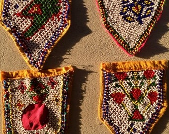 Four vintage beaded pockets from India