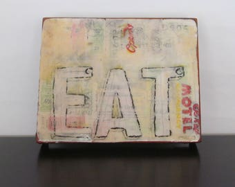 Eat Motel - mixed media on wooden cigar box top, ready to hang