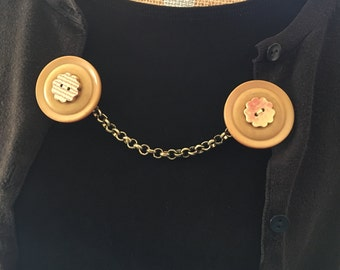 brown button sweater clip