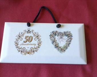 Ceramic plaque beveled edge with 50th anniversary.  3 by 6