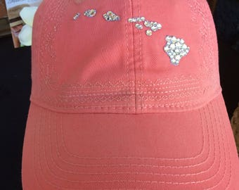 Baseball style coral-colored island chain hat embellished with clear Swarovski crystals