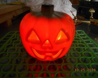 Vintage hard plastic pumpkin that lights up for Halloween