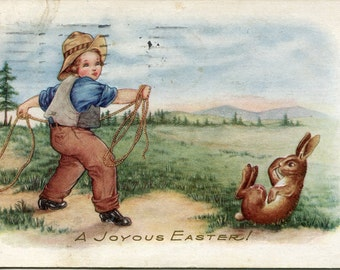 Easter postcard, A Joyous Easter, Little Boy trying to lasso Easter bunny rabbit vintage postcard, antique postcard, cowboy