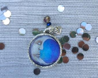 Sleeping half moon face pendant